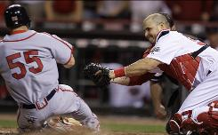 Cincinnati catcher Ramon Hernandez tags out the Cardinals' Skip Schumaker at home for the final out of the ninth inning, allowing the Reds to hold on for a 4-3 win.
