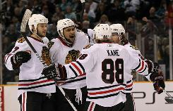 Blackhawks players celebrate a goal by Dustin Byfuglien on Sunday against the Sharks.
