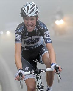 Denmark's Chris Sorensen pedals through the fog on his way to winning the eighth stage of the Giro d'Italia.