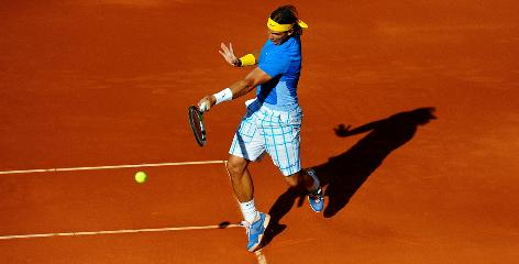 Rafael Nadal of Spain rips a forehand Sunday during his straight-sets victory against Roger Federer of Switzerland in the final of the Madrid Masters.