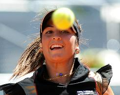 Aravane Rezai of France keeps her eyes on the ball during her victory Sunday against Venus Williams of the USA in the Madrid final.
