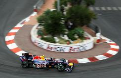 Mark Webber steers his Red Bull car through the Fairmont Hotel hairpin on the way to his first Monaco Grand Prix victory.