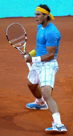Rafael Nadal of Spain celebrates a point during his victory Sunday against Roger Federer of Switzerland in the final of the Madrid Masters. The victory was Nadal's record 18th Masters 1000 title.