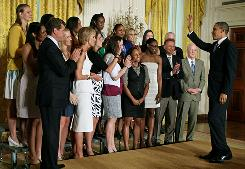 President Obama greets the Connecticut women's basketball team during a ceremony in the East Room at the White House to celebrate the Huskies' national championship