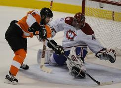 Flyers left wing Simon Gagne tries to score past Canadiens goalie Jaroslav Halak in Game 1 of the Eastern Conference finals. Sidelined for 17 days with a broken bone in his foot, Gagne has led the Flyers to a 6-0 record since his return.