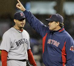 Boston Red Sox pitching coach John Farrell, right, gestures for a reliever after pitcher Josh Beckett surrendered a two-run double to Robinson Cano Tuesday night in the fifth inning.