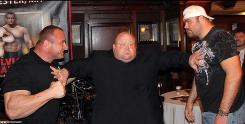 "Eric ""Butterbean"" Esch pretends to hold back Tim Sylvia, right, and Mariusz Pudzianowski, who are fighting Friday in a card promoted by Esch."