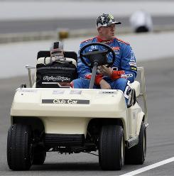 Paul Tracy, driving down pit road in a golf cart Monday during practice at Indianapolis Motor Speedway, hopes Barry Green can lead him to his first Indy 500 victory.