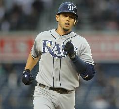 The Rays' Jason Bartlett rounds the Yankee Stadium bases after knocking out his first-inning solo home run in Tampa Bay's win.
