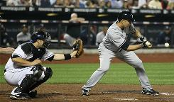 Yankees starting pitcher Javier Vazquez left the game after being hit on the finger laying down a sacrifice bunt in the seventh inning against the Mets.