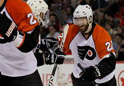 The Flyers' Ville Leino, right, celebrates after scoring a goal in the second period during Philadelphia's victory in Game 4 of the Eastern Conference finals. The Flyers took a 3-1 lead in the series.