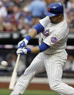The Mets' Angel Pagan connects on a RBI-single in the first inning against the Yankees. Pagan went 3-for-4 with two RBIs.
