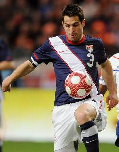 Carlos Bocanegra was kicked in the knee and compensated by running differently, causing an abdominal injury.