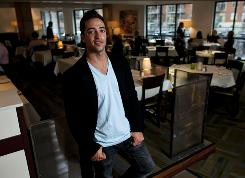 Milwaukee Brewers slugger Ryan Braun poses for a portrait at his new restaurant, Ryan Braun's Waterfront Grill, in Milwaukee. Braun says, &quot;I want my business portfolio to catch up with my baseball portfolio.&quot;