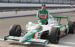 Tony Kanaan relaxes in his car after squeaking into the Indianapolis 500 field. Kanaan qualified 32nd in the 33-field lineup.
