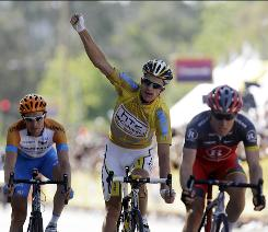 Michael Rogers, center, of Australia, celebrates at the finish line of the final stage, as he wins the Tour of California Sunday in Thousand Oaks, Calif. David Zabriskie, left, of the USA, finished in second overall, and Levi Leipheimer, right, also of the USA, finished in third. Ryder Hesjedal, of Canada, won the stage.