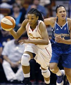 Tan White starts a fast break for the Sun while the Mystics' Marissa Coleman pursues during Connecticut's 80-65 victory. White scored a team-high 15 points.