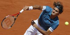 Defending champion Roger Federer of Switzerland rifles a shot Monday in his straight-sets victory against Peter Luczak of Australia during their first-round match at the French Open at Roland Garros in Paris.