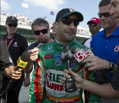 An emotional Tony Kanaan talks with the media after exiting his car following Bump Day qualifying for the Indianapolis 500.