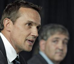 New Lightning general manager Steve Yzerman addresses a news conference as owner Jeff Vinik looks on.