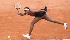 Venus Williams of the USA runs down a forehand during her 6-2, 6-4, second-round victory against Arantxa Parra Santonja of Spain on Wednesday at the French Open. Williams wre the same outfit that created a stir in her opening match.