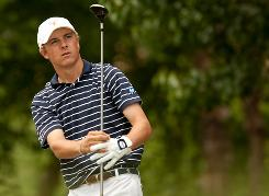 Jordan Spieth, 16, follows through on a tee shot during the final round of the HP Byron Nelson Championship in Irving, Texas, last week. Spieth finished the event in a tie for 16th place.