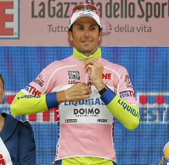Ivan Basso celebrates receiving the leader's pink jersey after stage 19 of the Giro of Italia.