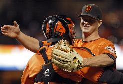 Giants pitcher Matt Cain embraces catcher Bengie Molina after throwing a complete-game, one-hit shutout against the Diamondbacks. The one-hit effort matched a career-best by Cain.