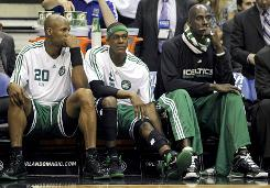 Celtics players Ray Allen, left, Rajon Rondo, middle, and Kevin Garnett watch from the bench during the final moments of their Game 5 to the Orlando Magic.