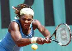 Serena Williams hits back at Germany's Julia Goerges during their second-round match at the French Open on Friday.