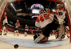 Flyers goalie Michael Leighton gives up a second-period goal. He was pulled after giving up five goals.