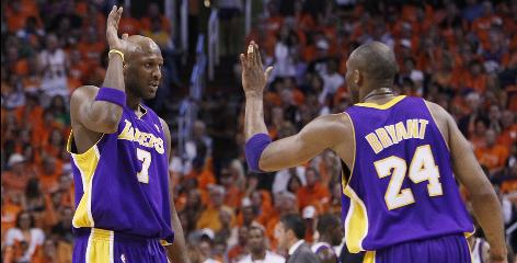 The Lakers' Lamar Odom, left, gets a high-five from Kobe Bryant during Game 6. Odom, Bryant and the Lakers return to the NBA Finals to attempt to defend their title.