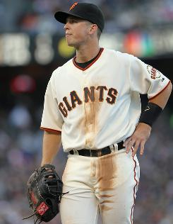The Giants' Buster Posey had three hits and drove in three runs in his first major league game, a rout of the Diamondbacks.