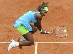 Serena Williams of the USA goes airborne to make this return in her third-round victory Saturday against Anastasia Pavlyuchenkova of Russia at the French Open in Paris. Williams won 6-1, 1-6, 6-2.