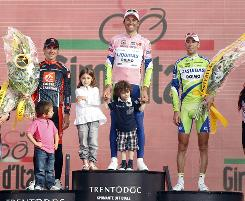 Ivan Basso stands atop the podium after winning the 2010 Giro d'Italia. David Arroyo Duran, left, finished second followed by Vincenzo Nibali, right, in third.