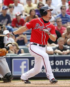 Pinch hitter Chipper Jones puts the Braves ahead with an RBI single in the eighth inning to help Atlanta earn its ninth win in its last at-bat.