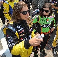 Simona de Silvestro, left, and Danica Patrick chat on the frontstretch before the start of the Indy 500.
