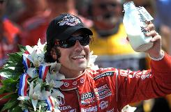 Dario Franchitti holds the traditional winner's bottle of milk in victory lane at Indianapolis Motor Speedway.