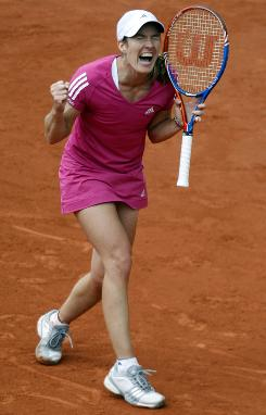 Belgium's Justine Henin celebrates the completion of her third-round victory against Maria Sharapova on Sunday at the French Open.