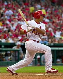 The Cardinals' Jon Jay connects for a two-run pinch-hit double against the Reds in the bottom of the sixth inning. St. Louis won 12-4.