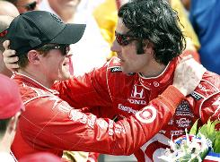 Scotland's Dario Franchitti is congratulated in victory lane by another former Indy winner, teammate Scott Dixon of New Zealand. Foreign drivers have won 10 of the last 12 Indy 500s.