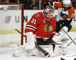 Antti Niemi, who is in his first full season in the NHL, makes a save in the third period of Game 2 against the Flyers.