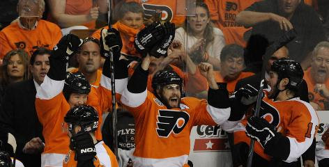 The Flyers' bench erupts in celebration when Scott Hartnell's goal is ruled good after a video review.