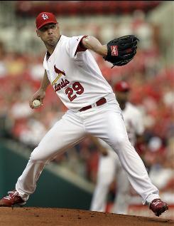 Cardinals pitcher Chris Carpenter won his eighth straight start against the Cincinnati Reds.