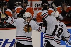 Chicago's Patrick Kane, left, celebrates his third-period goal with teammate Jonathan Toews. Both picked up their first points of the series Wednesday night.