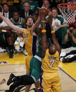 Pau Gasol, left, finished with a double-double and a game-high three blocks, including this one on Boston's Glen Davis in Game 1.