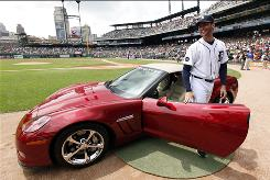 Tigers pitcher Armando Galarraga smiles after being presented with a Chevrolet Corvette convertible before Thursday's game against the Indians.