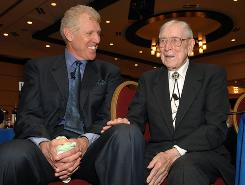 Former UCLA star Bill Walton, left, says he visited Hall of Fame coach John Wooden, right, at UCLA Medical Center two days ago.