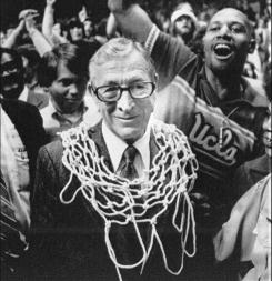 John Wooden smiles on the court after his UCLA team won the national title in 1975, the 10th championship he won with the team.