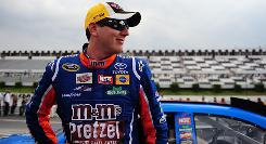 Kyle Busch smiles on pit road at Pocono Raceway during Friday's qualifying session.